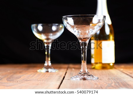 Sparkling wine and two glasses on table for celebration