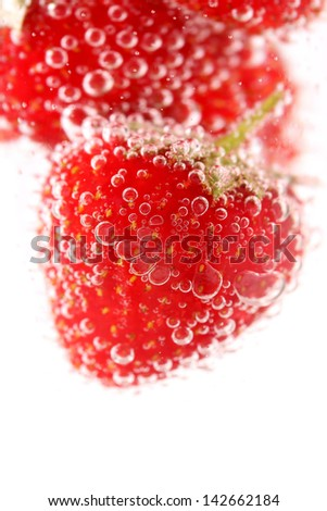 Sparkling wine (champagne) and strawberry on a white background - stock photo