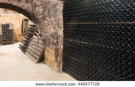 Sparkling wine glass  bottles fermenting  in   cellar   - stock photo