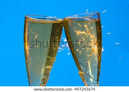 Sparkling Wine in glasses/Champagne Toast/Bubbles in golden liquid