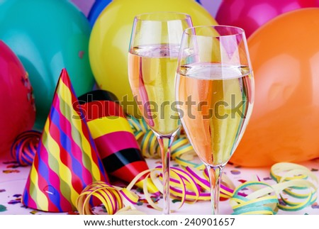 Sparkling wine, streamers, confetti and party hat/party/carnival