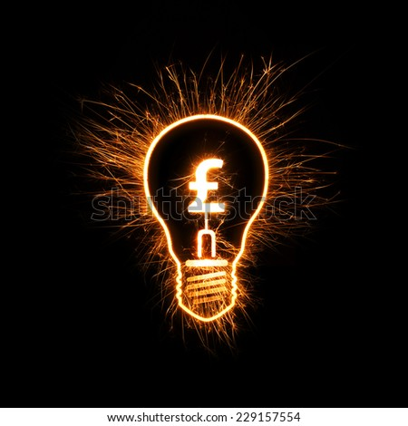 Sparkly light bulb and British pound sign representing bright idea in finance-related concept. - stock photo