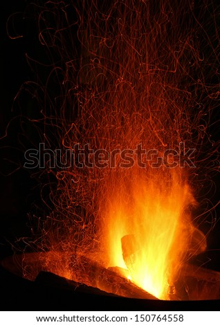 Sparks and Embers flying off a bonfire