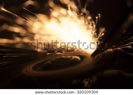 Sparks at grinding steel on black background