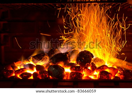 Sparks coming out of a barbecue - stock photo