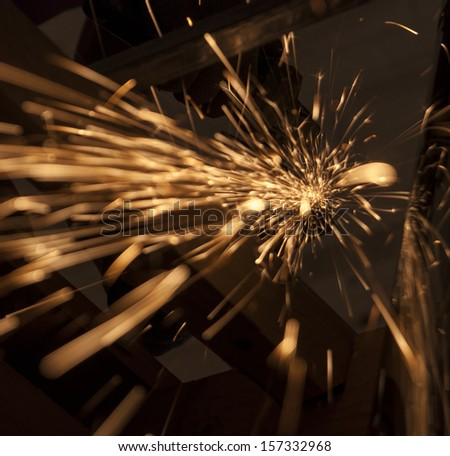 Sparks during cutting of metal - stock photo