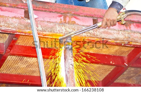 Sparks during cutting of metal by gas welding in site. - stock photo