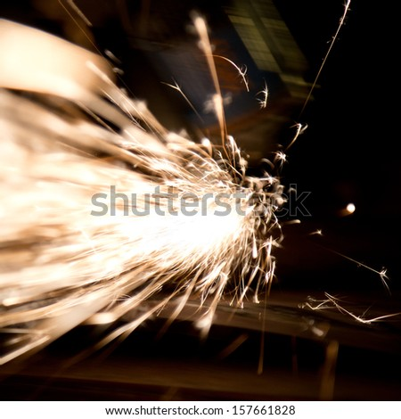 Sparks during metal cutting over black