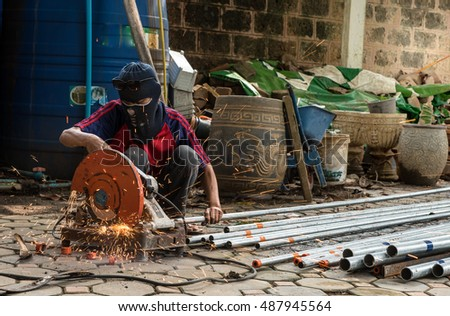 Sparks from cutting metal abrasive disk of angle grinder. Industrial concept.