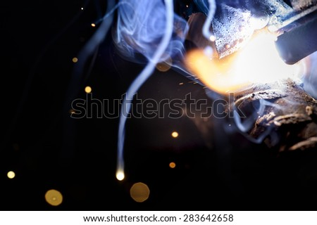 Sparks from welding close-up. - stock photo