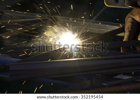 Sparks from welding steel was working.