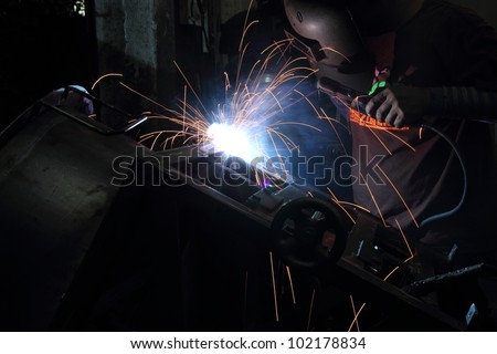 Sparks from welding, working with the heat