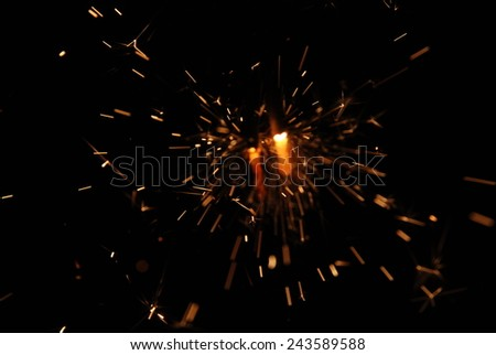 Sparks. Glowing Flow of Sparks in the Dark - stock photo
