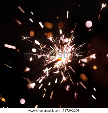 Sparks of Bengal fire on a black background - stock photo