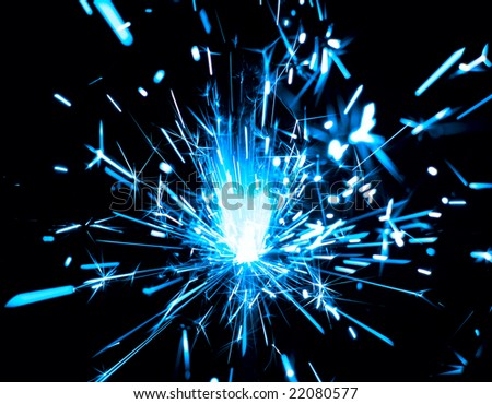 Sparks of bengal light on black background - stock photo