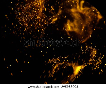 sparks of fire on a black background - stock photo