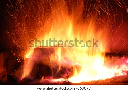 Sparks Rising from Burning Logs - stock photo