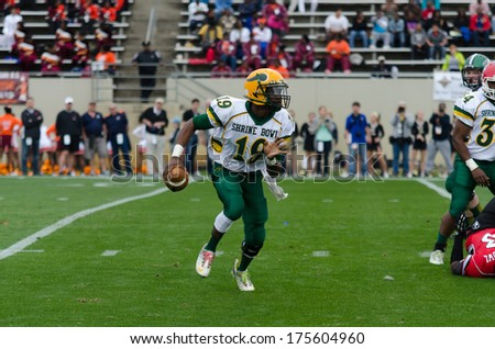 SPARTANBURG, SC - DEC 21, 2013 #19 Hasaan Klugh rolls out looking for a receiver in the Shrine Bowl - stock photo