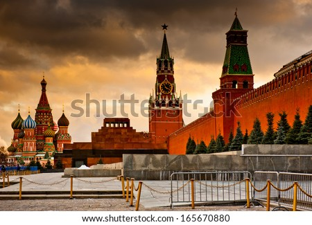 Spasskaya Tower and St. Basil's Cathedral on Red square (at sunset). Moscow. Russia - stock photo
