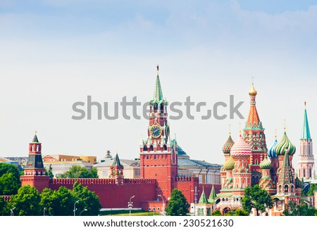 Spasskaya Tower and St. Basil's Cathedral on Red square in summer day. Moscow. Russia - stock photo