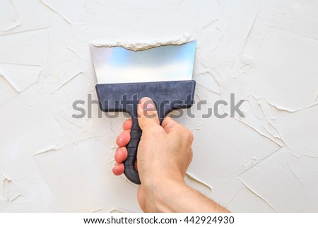 spatula in hand  - stock photo