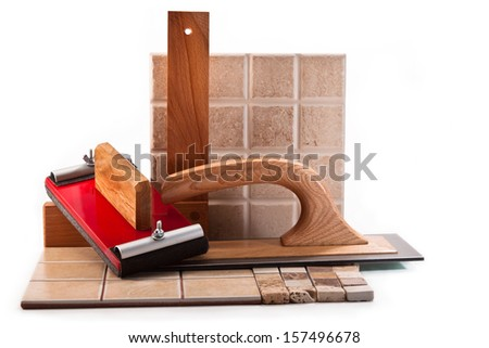 Spatula, wooden square, a device for clamping the sandpaper, ceramic tile on a white background - stock photo