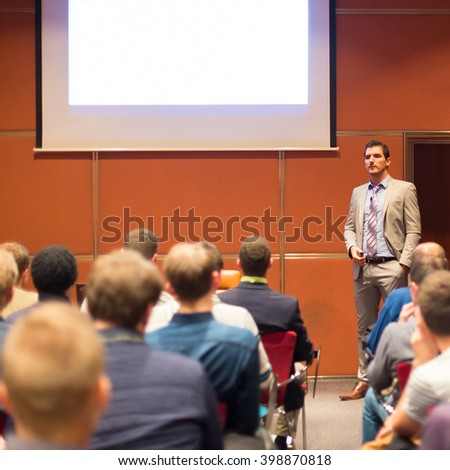 Speaker Giving a Talk at Business Meeting. Audience in the conference hall. Business and Entrepreneurship concept. - stock photo