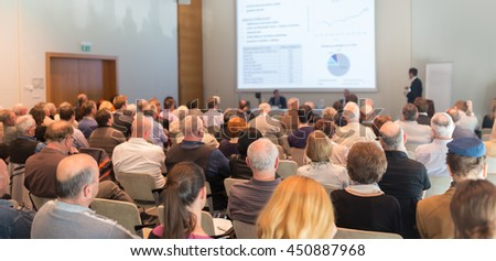 Speaker Giving a Talk at Business Meeting. Audience in the conference hall. Business and Entrepreneurship. - stock photo
