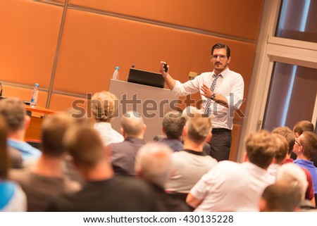 Speaker giving a talk in conference hall at business event. Audience at the conference hall. Business and Entrepreneurship. - stock photo