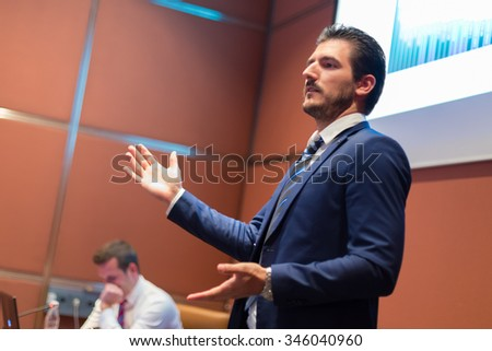 Speaker giving talk on podium at Business Conference. Entrepreneurship club. Horisontal composition.  - stock photo