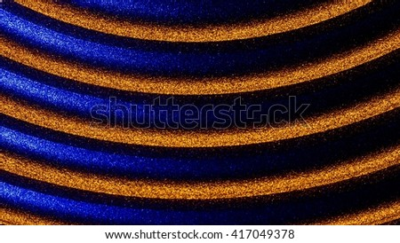 speaker membrane  illuminated with blue and orange executed in macro style - stock photo
