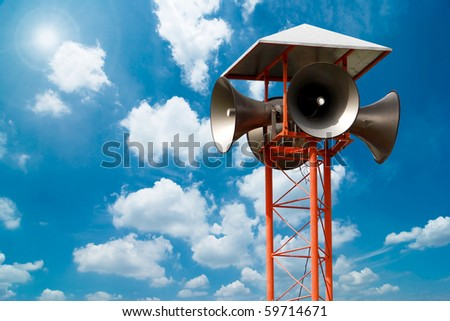 Speaker on high tower and clear sky - stock photo