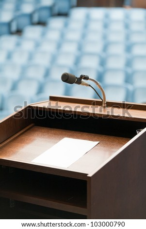 Speaker's table with paper, your text possible - stock photo