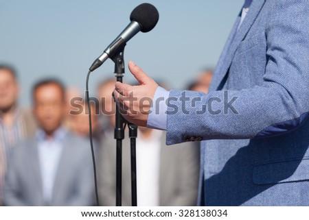 Speaker. Speech. Microphone. News Conference. - stock photo