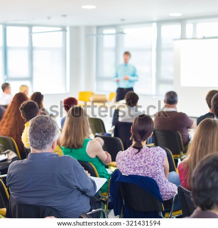 Speakers Giving a Talk at Business Meeting. Audience in the conference hall. Business and Entrepreneurship concept. - stock photo