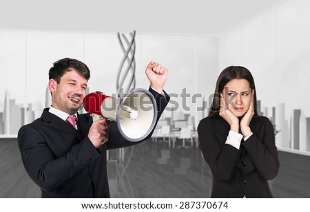 Speaking boss with megaphon. Worker Closing ears - stock photo