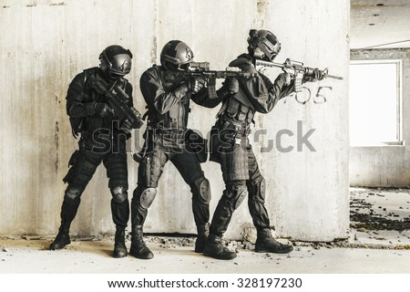 Spec ops police officers SWAT in action - stock photo