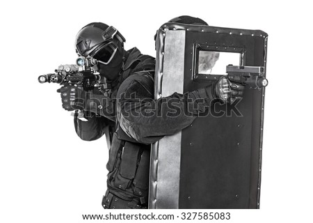 Spec ops police officers SWAT with ballistic shield studio shot