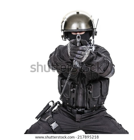 Spec ops soldier in black uniform and face mask aiming his pistol - stock photo