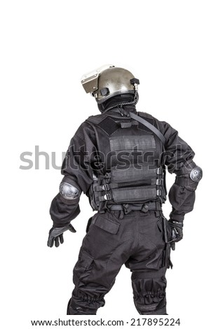Spec ops soldier in black uniform and face mask shot from behind - stock photo