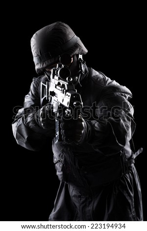 Spec ops soldier on black background - stock photo