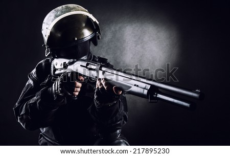 Spec ops soldier on black background with shotgun - stock photo