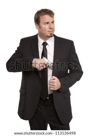 Special Agent draws his weapon - stock photo