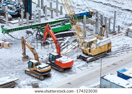 Special construction machinery on the construction site in winter season - stock photo