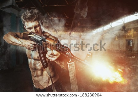 Special force man with the assault rifle gun in battle