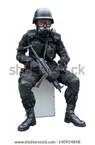 Special force soldier wearing gask mask sitting in isolation background - stock photo