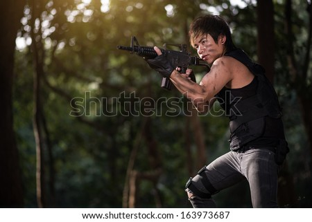 Special force with the gun in the jungle