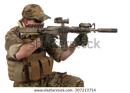 special forces operator with assault rifle on white background - stock photo