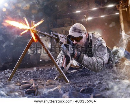 Special forces sniper is shooting the enemy - stock photo