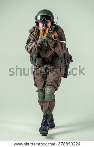 Special forces soldier with rifle on white background